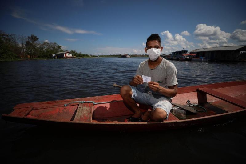 Drive-thru fluvial favorece população ribeirinha de Iranduba durante campanha Vacina Amazonas